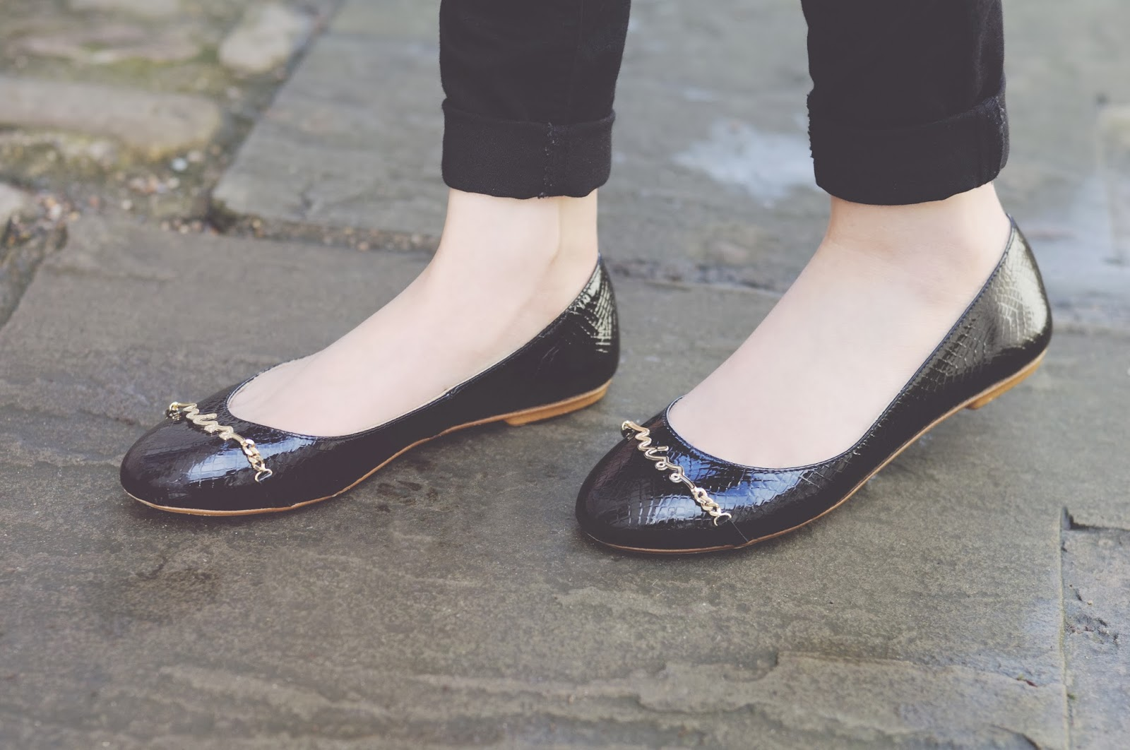 black and gold ballet pump shoes