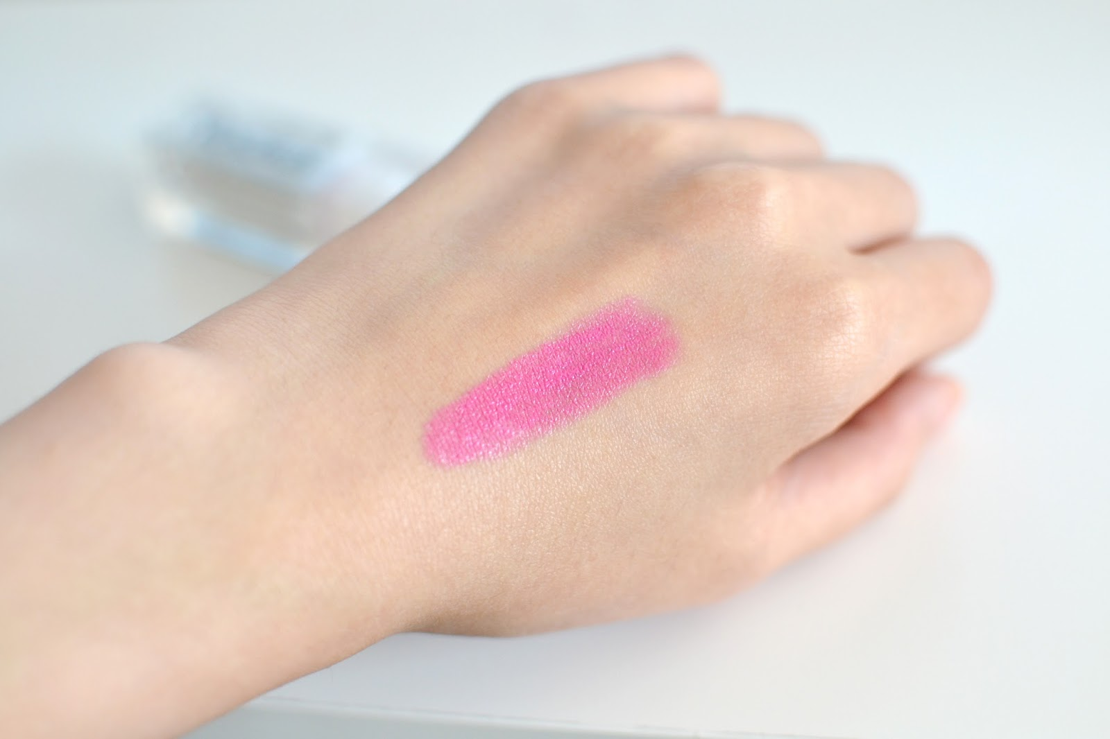 rodial glamstick blow swatch, blue toned pink