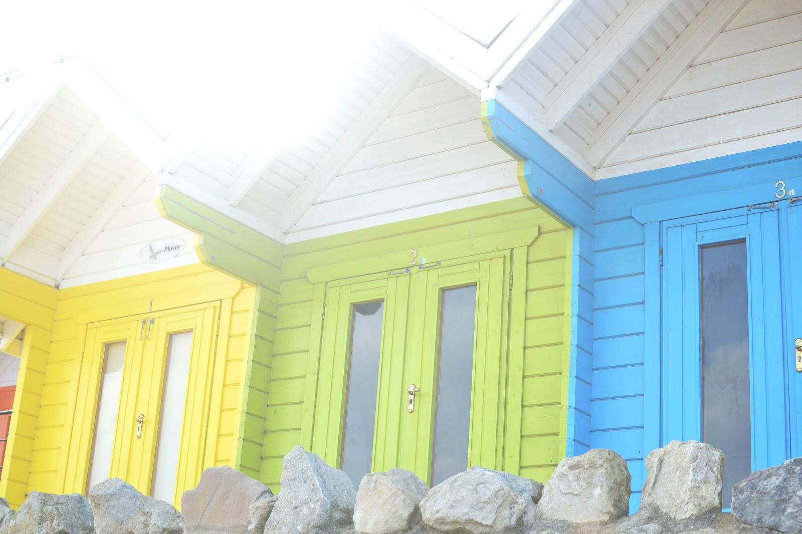 colourful beach huts, british seaside, beach huts, scarborough beach huts