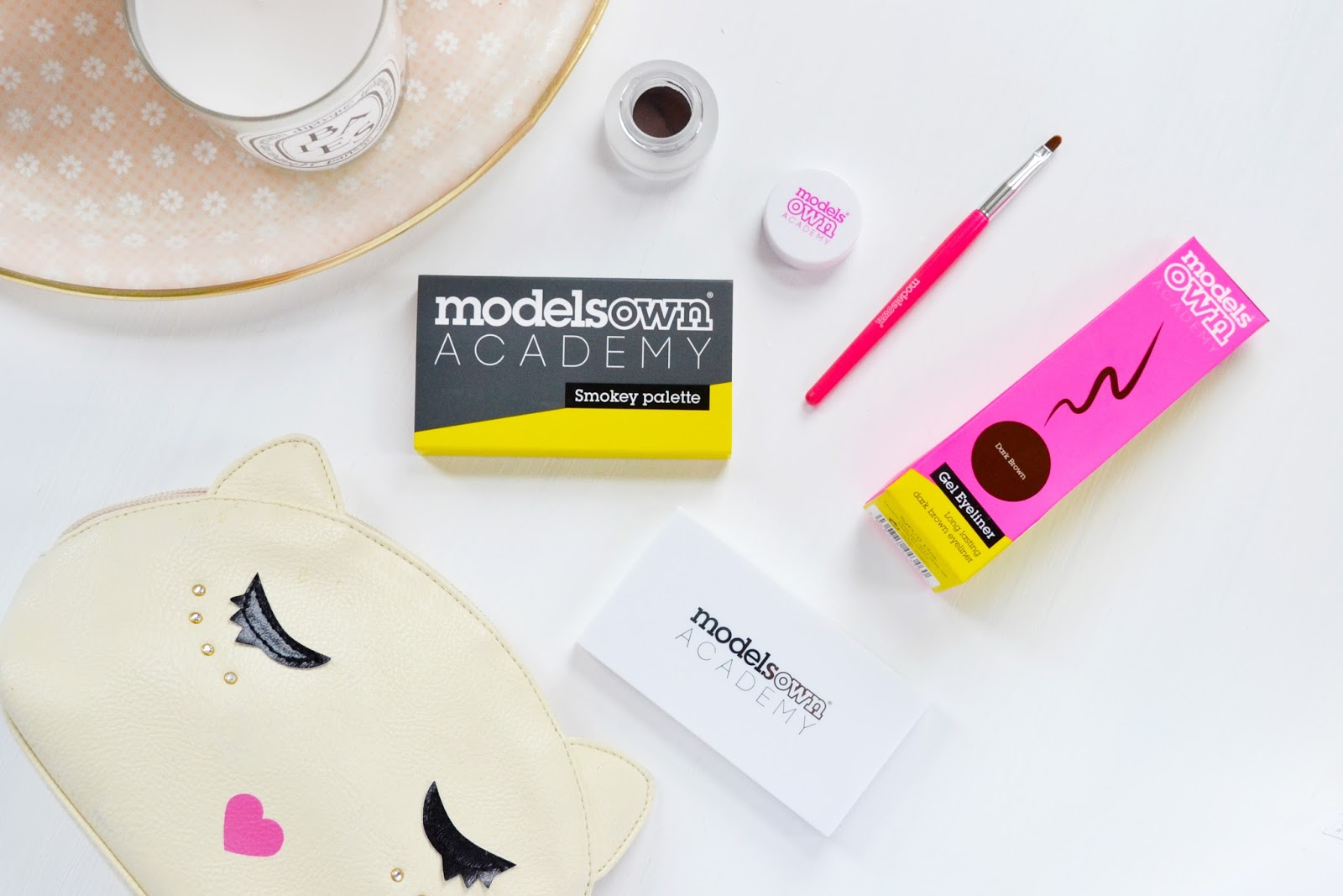 Eye make up from models own including smokey eye palette and gel eyeliner