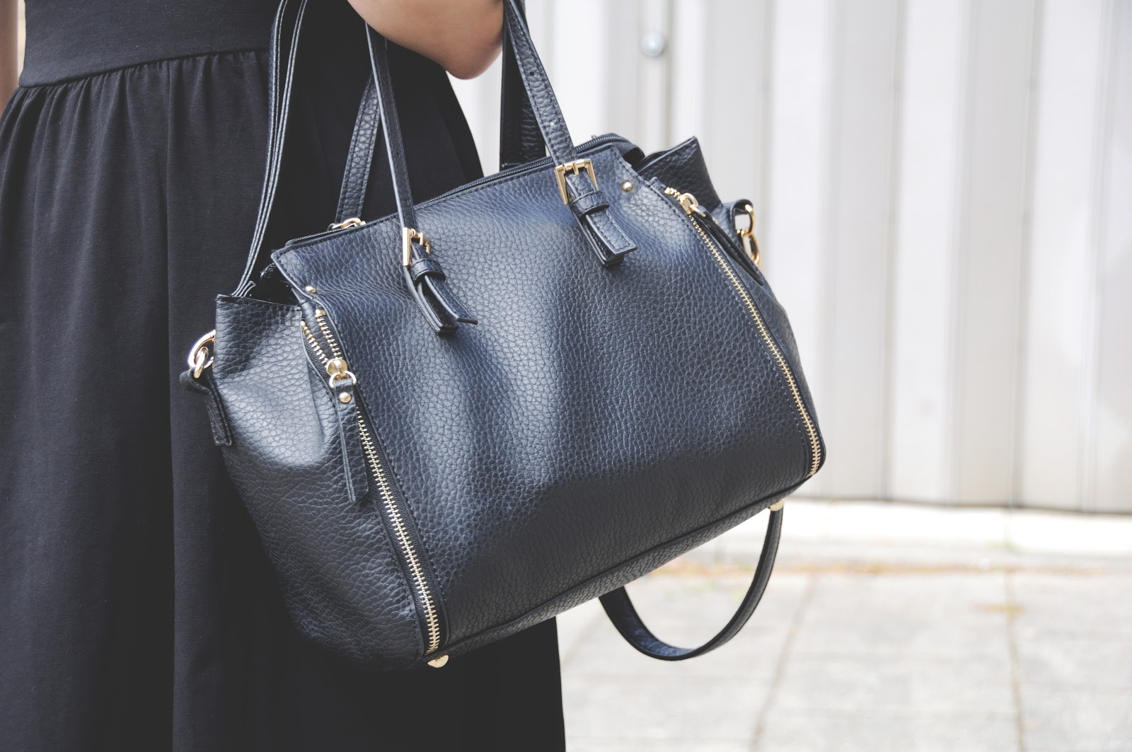 trendy black and gold bag